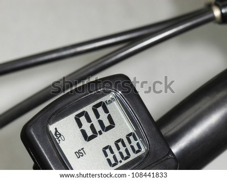 Black bicycle  electronic speedometer odometer on gray background