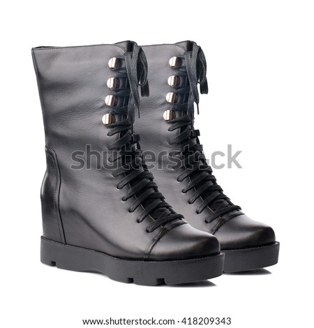 Black biker high boots isolated on white background.
