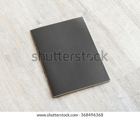 Black blank leather cover book template on white grey colour wooden table background: Empty business notebook cover on light gray color tone wood floor: School note paperback cover mockup display  - stock photo