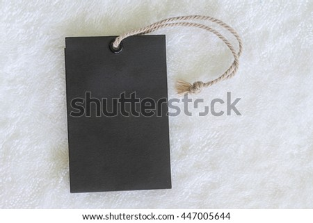 black blank price tag on fabric background