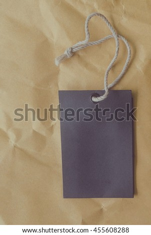 black blank price tag on wood background, Vintage tone filter