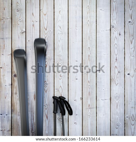 black blank skis on wooden planks wall, winter background - stock photo