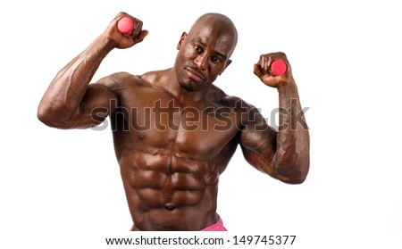 Black bodybuilder smiling and holding two pink small dumbbells. Strong man with perfect abs, pecs shoulders,biceps, triceps. Isolated on white background