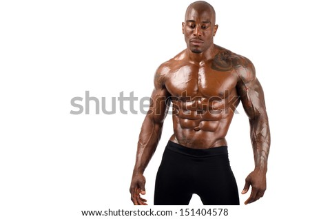Black bodybuilder topless, showing his muscles. Strong man with perfect abs, shoulders,biceps, triceps and chest. Isolated on white background - stock photo