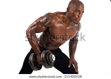 Black bodybuilder training with dumbbells. Black bodybuilder topless, showing his muscles. Strong man with perfect abs, shoulders,biceps, triceps and chest. Isolated on white background