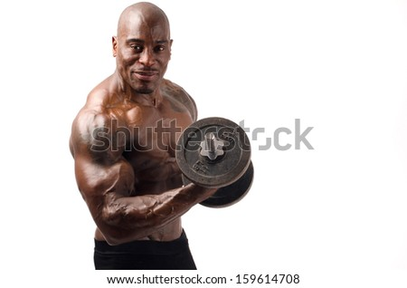 Black bodybuilder training with heavy dumbbell. Strong man with perfect abs, shoulders,biceps, triceps and chest. Isolated on white background