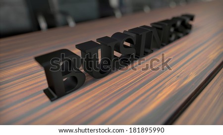 black bold word ''business'' on wooden desk with depth of field