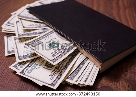 black book and money,business plan, money background, hundred dollar bills front side. background of dollars, money in the black book, the work of a writer