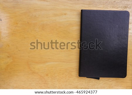 Black book on a wooden table