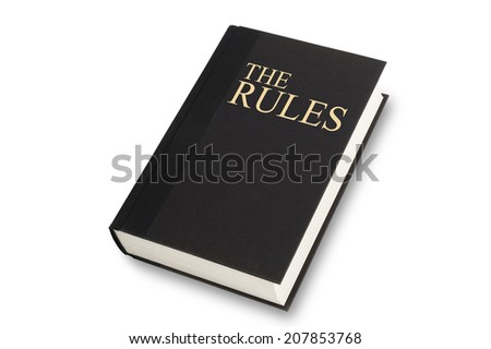 Black book with the words The Rules title on front. Isolated on white with path