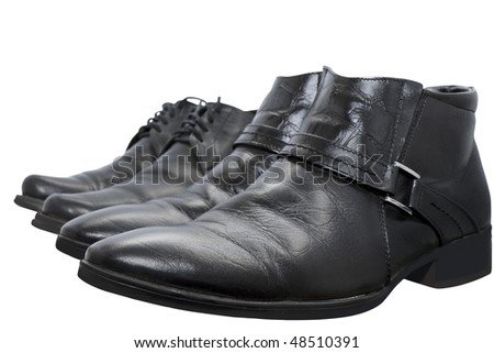 black boots isolated on a white background with focusing on near-toe shoes