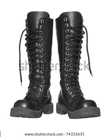 Black boots on a white background. - stock photo