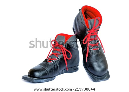 Black boots with red finishing for skiing. Are presented on a white background. - stock photo