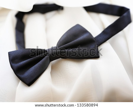 Black bow tie, isolated on white background