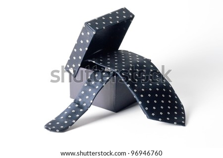 black box from which hangs a tie white background - stock photo