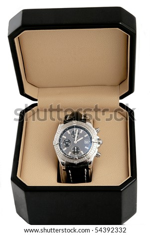black box with luxury watch on white background