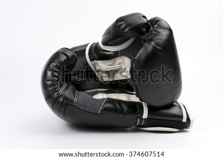 Black boxing glove - stock photo