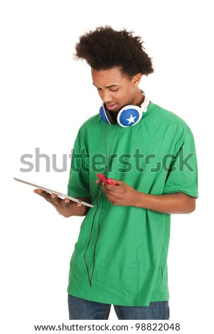 Black boy is having tablet and smart phone - stock photo
