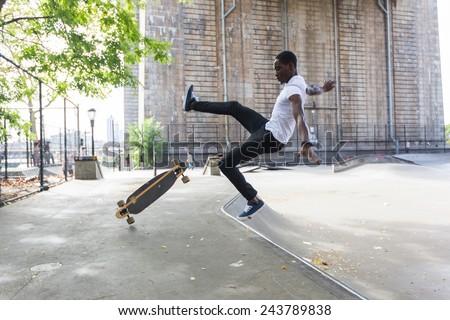 Black Boy Skating at Park and Falling Down - stock photo