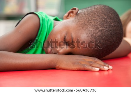 Black boy sleeping in kindergarten