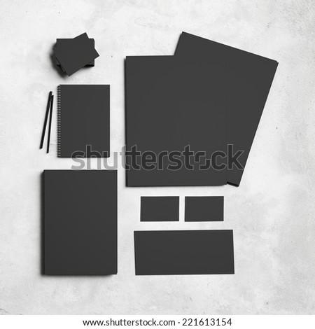 Black branding elements on concrete background - stock photo