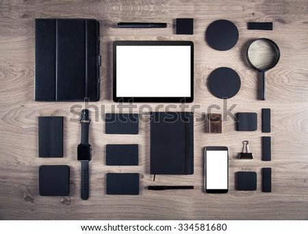 Black branding mockup. Template set on wood background - stock photo