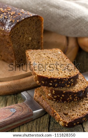 Black bread with sesame seeds - stock photo