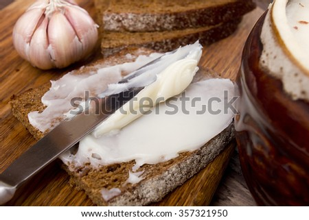 Black bread with the softened lard as a snack in the recipe. - stock photo