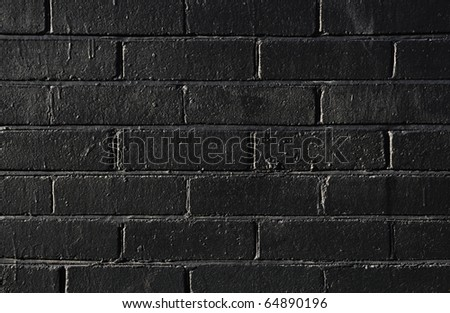 Black brick wall background - stock photo