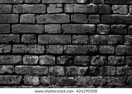 Black brick wall of a dead end. It embodies the inability to move on.  - stock photo