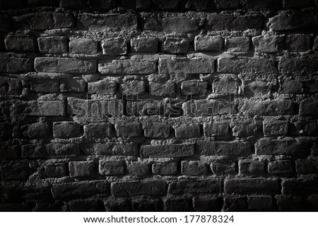 Black brick wall. Vignetting added. Great for background - stock photo