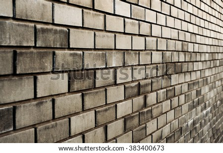 black brick wall with diminishing perspective closeup