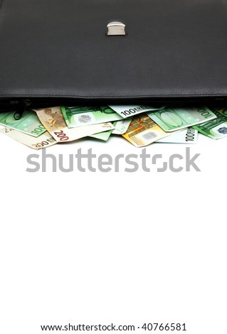 Black briefcase with money - stock photo