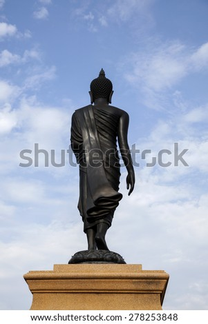 black buddha statue on blue sky - stock photo