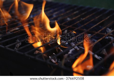 black burned charcoal bbq grid fire natural as background - stock photo