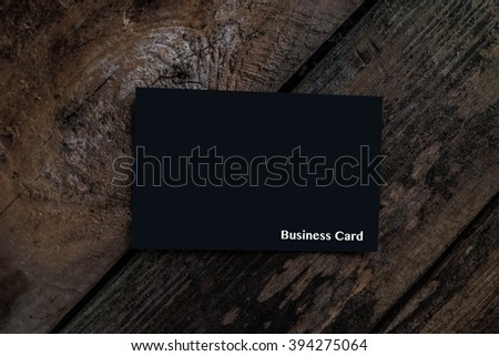 Black Business Card on Wood - stock photo