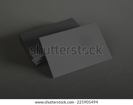 Black business cards on textile background - stock photo