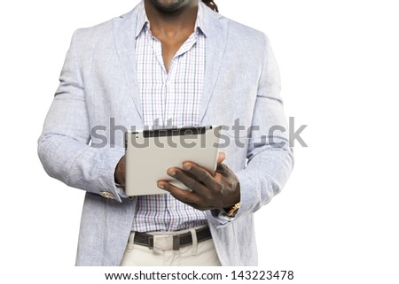 Black business man in light suit using tablet computer against white background
