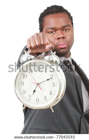 Black businessman with large alarm clock