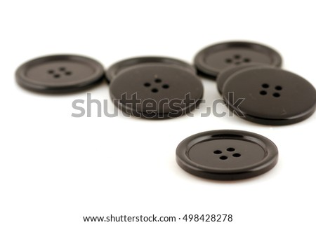 black buttons against light background