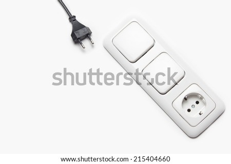 Black cable and the light switch. - stock photo