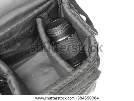 black camera bag on open, have  lens white background , select focus Top view - stock photo