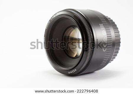 Black camera lens isolated on white background - stock photo