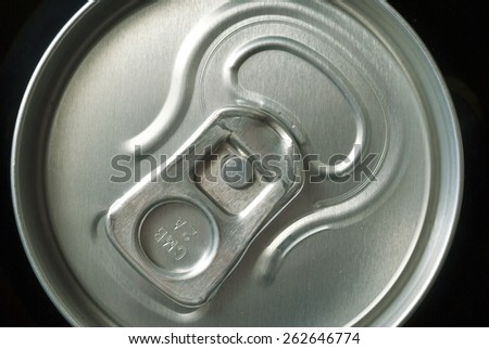 black canned drink in dark - stock photo