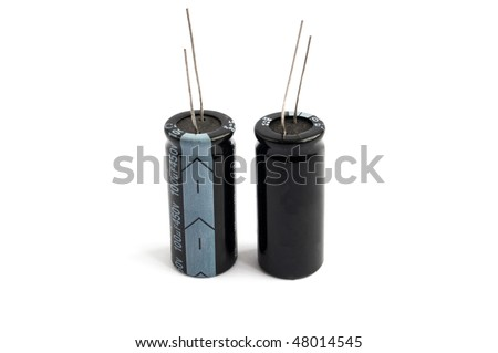 black capacitors against a white background