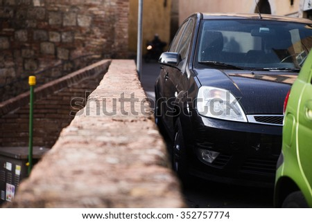 black car close to the brick wall - stock photo