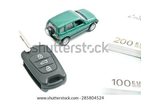 black car keys, euro notes and green car on white - stock photo