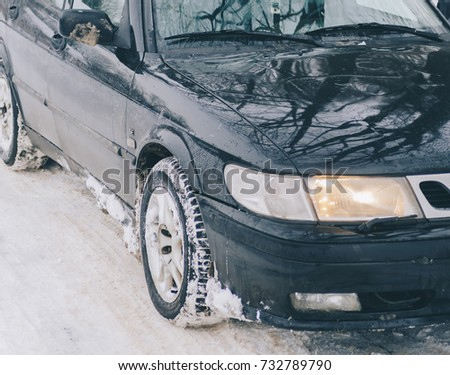 Black car on road in winter time