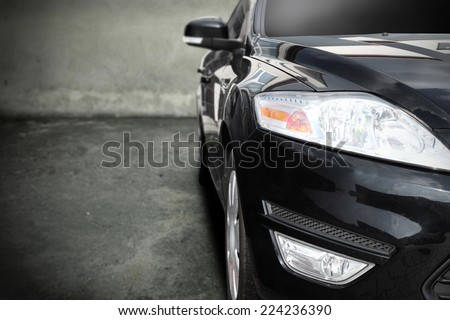 black car without a trade brand in interior of garage  - stock photo