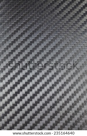 Black carbon kevlar fiber background. - stock photo